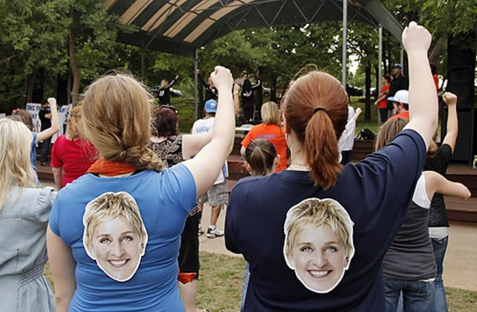 Photo -  Girls with Ellen on their shirts learn the dance steps during a Thunder mob dance to send to Ellen DeGeneres at Hafer Park in Edmond Wednesday, May 18, 2011. Photo by Doug Hoke, The Oklahoman. ORG XMIT: KOD