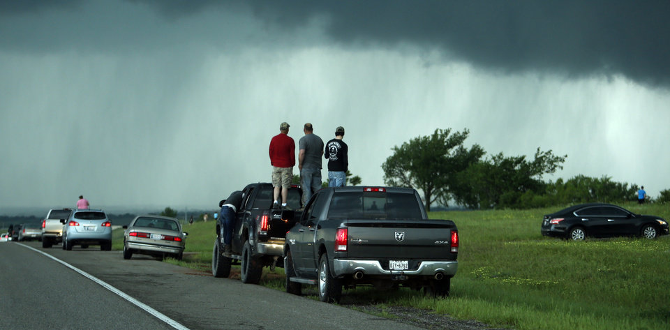 Photo - Motorists stop on State Highway 9 near May Ave. to watch as clouds producing a tornado pass through Newcastle on Wednesday, May 6, 2015.  Photo by Steve Sisney, The Oklahoman