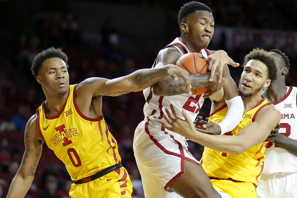 Photo - Oklahoma's Kristian Doolittle (21) fights for the ball with Iowa State's Zion Griffin (0) and George Conditt IV (4) during an NCAA basketball game between the University of Oklahoma Sooners (OU) and the Iowa State Cyclones at the Lloyd Noble Center in Norman, Okla., Wednesday, Feb. 12, 2020. [Bryan Terry/The Oklahoman]