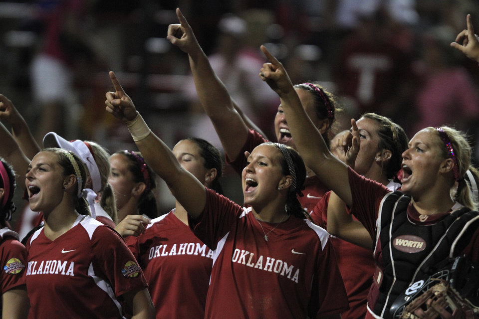 The Oklahoma University Sooners celebrate after winning a game against  Alabama at ASA Hall of Fame Stadium in Oklahoma City, Monday, June 4, 2012.  Photo by Garett Fisbeck, The Oklahoman
