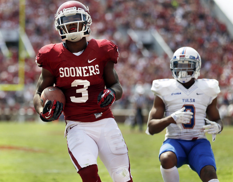 Photo - Oklahoma's Sterling Shepard (3) makes a touchdown reception during the second half of a college football game between the University of Oklahoma Sooners (OU) and the Tulsa Golden Hurricane (TU) at Gaylord Family-Oklahoma Memorial Stadium in Norman, Okla., on Saturday, Sept. 14, 2013. Photo by Steve Sisney, The Oklahoman