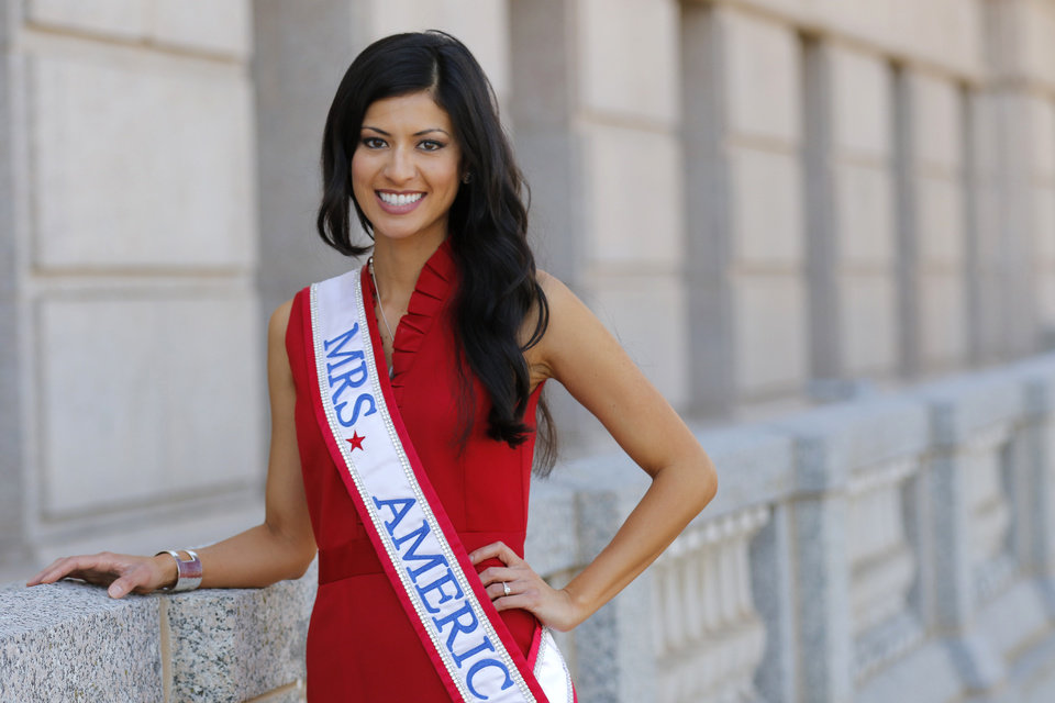 Photo - Mrs. America 2015 Michelle Evans poses for a photo March 25 during Oklahoma Nurses Day at the State Capitol in Oklahoma City . Evans is a neonatal nurse and lost her brother to a drug overdose.  Photo By Steve Gooch, The Oklahoman  Steve Gooch -  The Oklahoman
