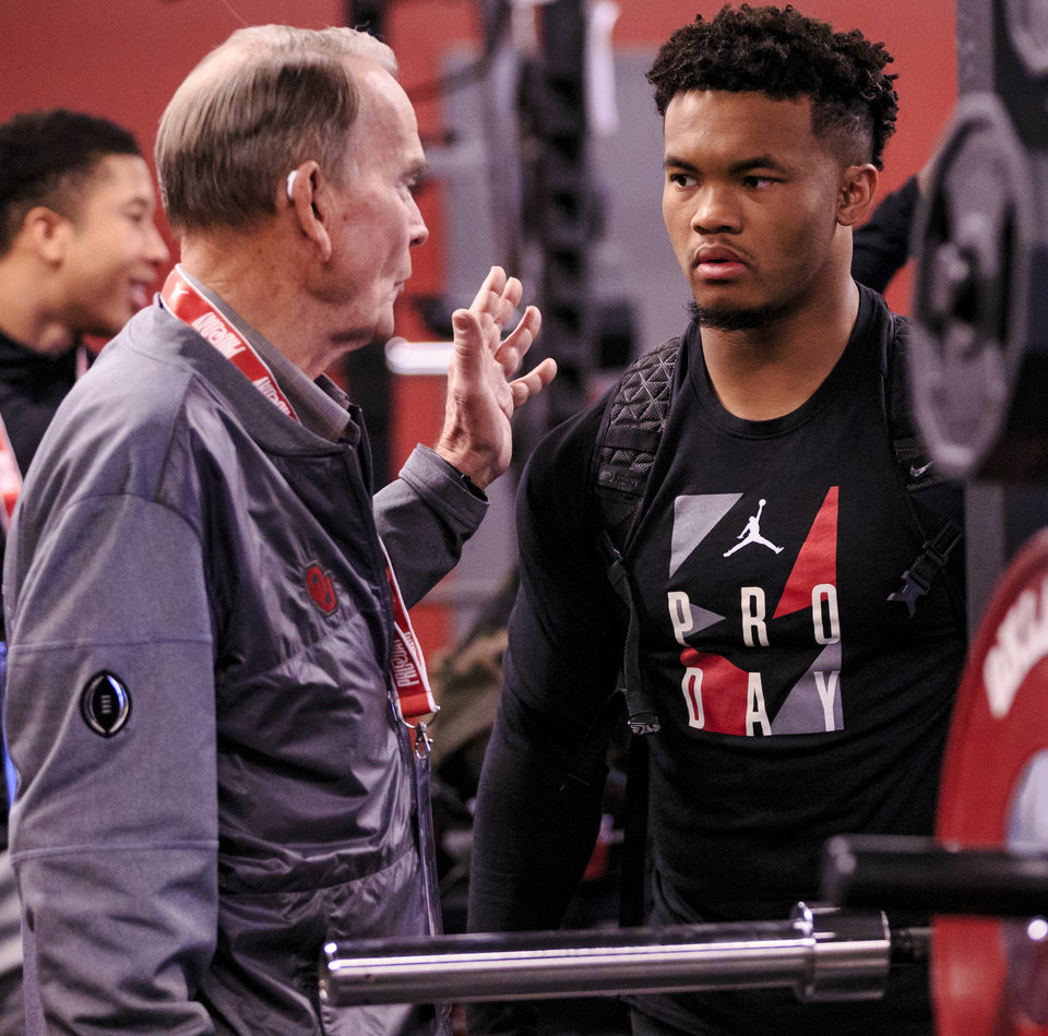 Photo - Merv Johnson talks with Kyler Murray before for the start of the University of Oklahoma football pro day at the University of Oklahoma in Norman, Okla. on Wednesday, March 13, 2019.   Photo by Chris Landsberger, The Oklahoman