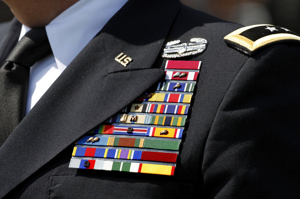 The uniform of highly decorated Gen. Myles Deering bears numerous medals, awards, and campaign ribbons at the Memorial Day Ceremony on the grounds of the 45th Infantry Division Museum on Monday, May 28, 2012, Deering its adjutant general of the Oklahoma Army and Air National Guard. Photo by Jim Beckel, The Oklahoman