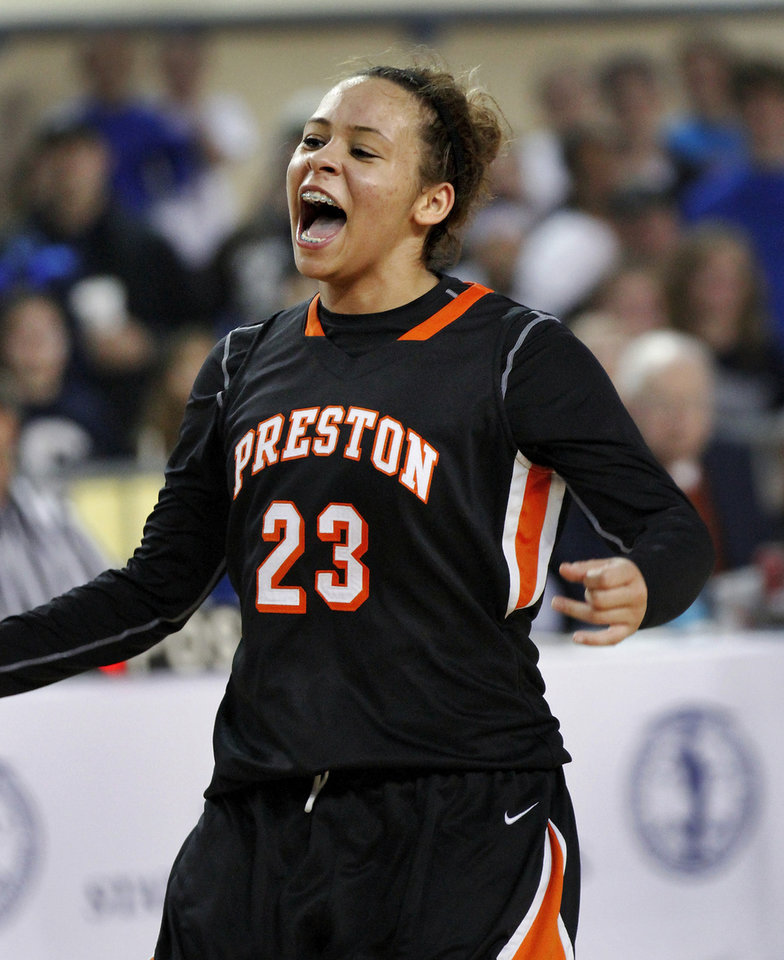 Photo - Jubilation on her face, Preston sophomore Chelsea Dungee smiles after hitting free throws in the final seconds of the game which essentially secured her team's victory in the Class 2A Girls State Championship game between Preston and Cordell at Jim Norick Arena at State Fair Park  on Saturday, Mar. 15, 2014.  Preston won,  45-41. Photo by Jim Beckel, The Oklahoman