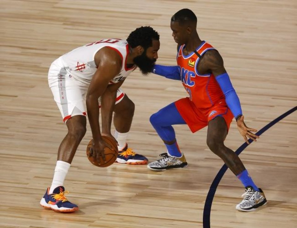 Photo -  Aug 22, 2020; Lake Buena Vista, Florida, USA; Dennis Schroder #17 of the Oklahoma City Thunder defends against James Harden #13 of the Houston Rockets  during the second quarter in game three of the first round of the 2020 NBA Playoffs at The Field House. Mandatory Credit: Mike Ehrmann/Pool Photo-USA TODAY Sports