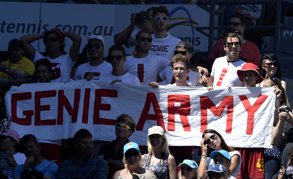 Photo - Supporters of Canada's Eugenie Bouchard watch her quarterfinal against  Ana Ivanovic of Serbia at the Australian Open tennis championship in Melbourne, Australia, Tuesday, Jan. 21, 2014. (AP Photo/Andrew Brownbill)