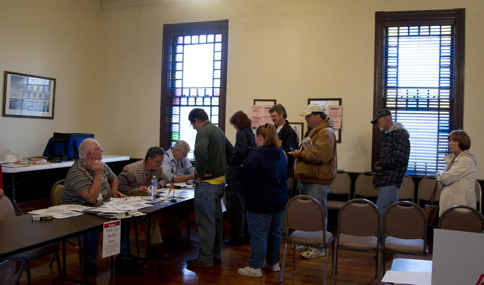 Voters line up to cast ballots at Kanwaka Township Hall near Lawrence, Kan., Tuesday, Nov. 6, 2012. (AP Photo/Orlin Wagner)