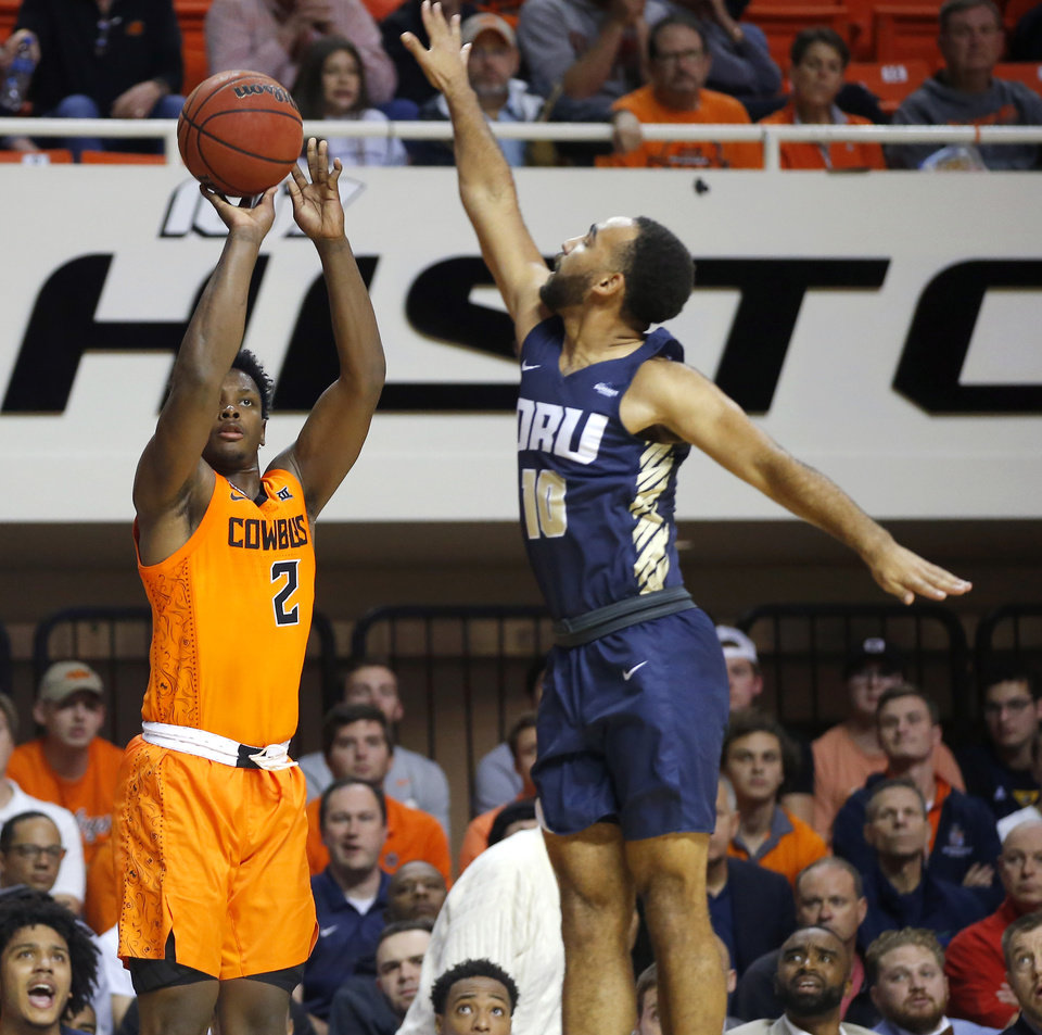 Photo - Oklahoma State's Chris Harris Jr. (2) as Oral Roberts' Sam Kearns (10) defends during an NCAA basketball game between the Oklahoma State University Cowboys (OSU) and the Oral Roberts Golden Eagles (ORU) at Gallagher-Iba Arena in Stillwater, Okla., Wednesday, Nov. 6, 2019. [Bryan Terry/The Oklahoman]