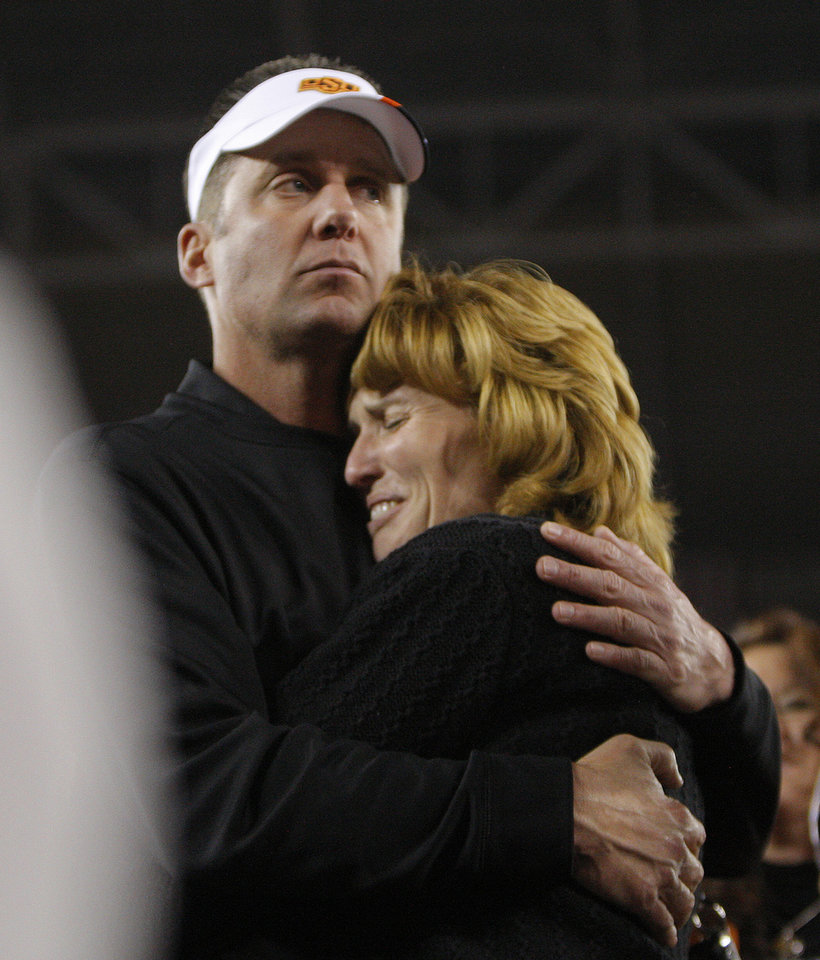 Photo - Oklahoma State football coach hugs Shelley Budke during the Fiesta Bowl between the Oklahoma State University Cowboys (OSU) and the Stanford Cardinal at the University of Phoenix Stadium in Glendale, Ariz., Tuesday, Jan. 3, 2012. Photo by Sarah Phipps, The Oklahoman