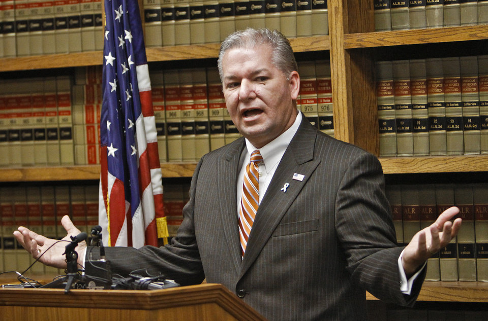 Photo - Oklahoma County district attorney David Prater addresses the media during a press conference at the Oklahoma County Office Building on Friday, Sept. 3, 2010, in Oklahoma City, Okla.   Photo by Chris Landsberger, The Oklahoman