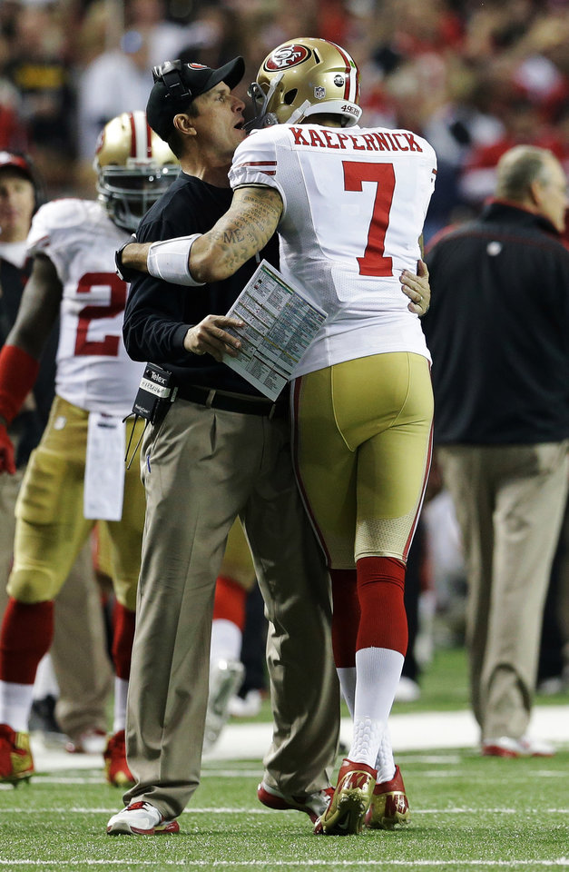 San Francisco 49ers head coach Jim Harbaugh celebrates with Colin Kaepernick (7) after a touchdown during the second half of the NFL football NFC Championship game against the Atlanta Falcons Sunday, Jan. 20, 2013, in Atlanta. (AP Photo/Mark Humphrey)