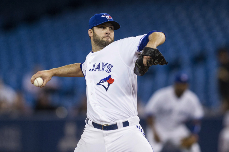 Photo - Toronto Blue Jays starting pitcher Brandon Morrow works against the Houston Astros during the first inning of a baseball game Wednesday, April 9, 2014, in Toronto. (AP Photo/The Canadian Press, Chris Young)