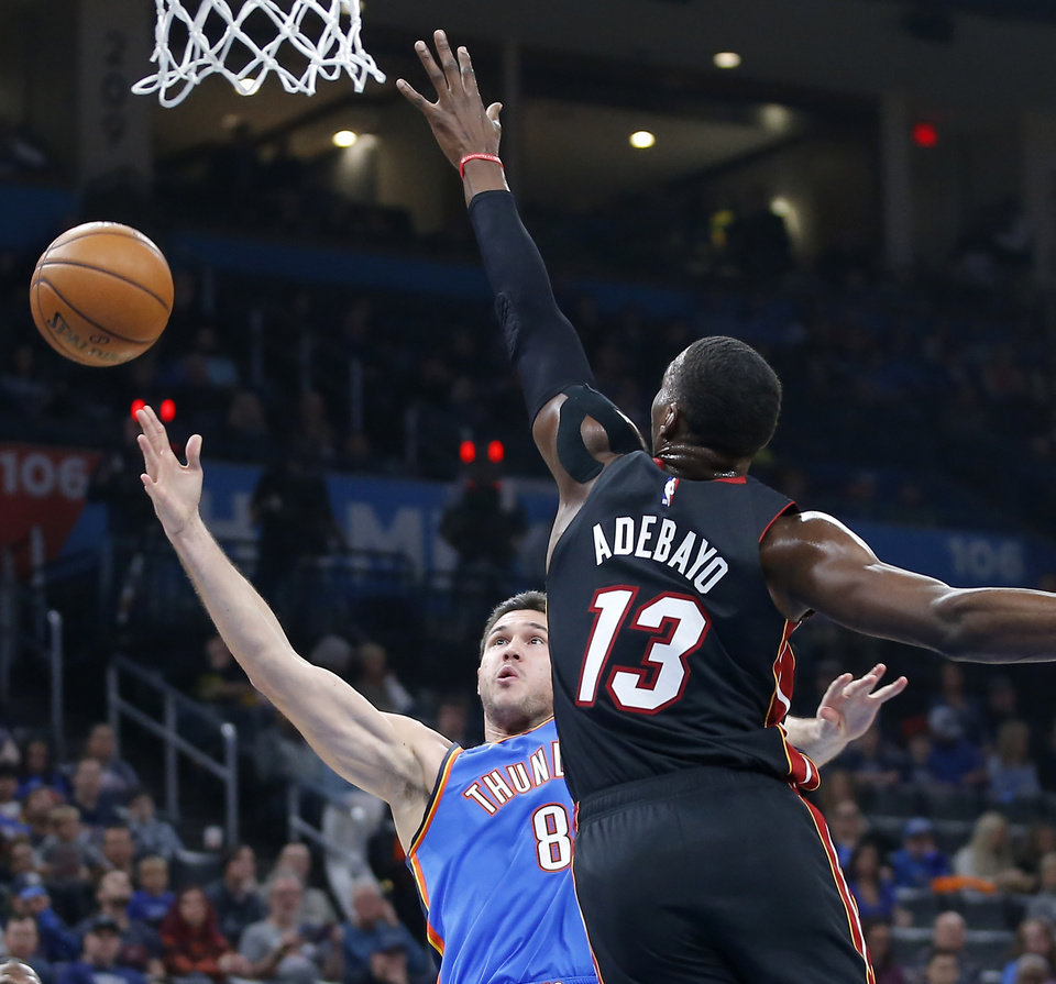 Photo - Oklahoma City's Danilo Gallinari (8) puts up a shot beside Miami's Bam Adebayo (13) during an NBA basketball game between the Oklahoma City Thunder and the Miami Heat at Chesapeake Energy Arena in Oklahoma City, Friday, Jan. 17, 2020. Oklahoma State lost 76-64. [Bryan Terry/The Oklahoman]