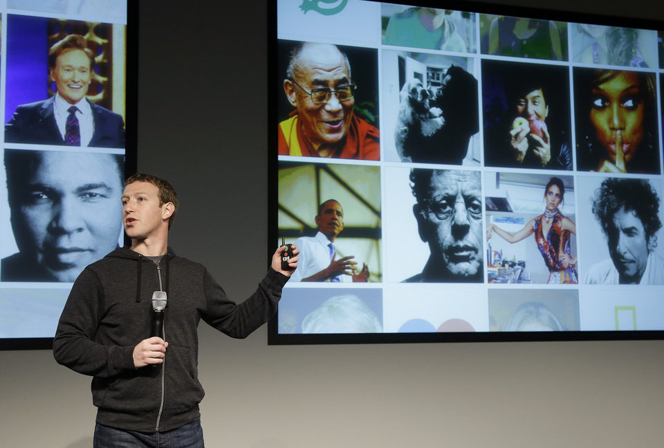 Photo - Facebook CEO Mark Zuckerberg speaks at Facebook headquarters in Menlo Park, Calif., Thursday, March 7, 2013. Zuckerberg on Thursday unveiled a new look for the social network's News Feed, the place where its 1 billion users congregate to see what's happening with their friends, family and favorite businesses.(AP Photo/Jeff Chiu)