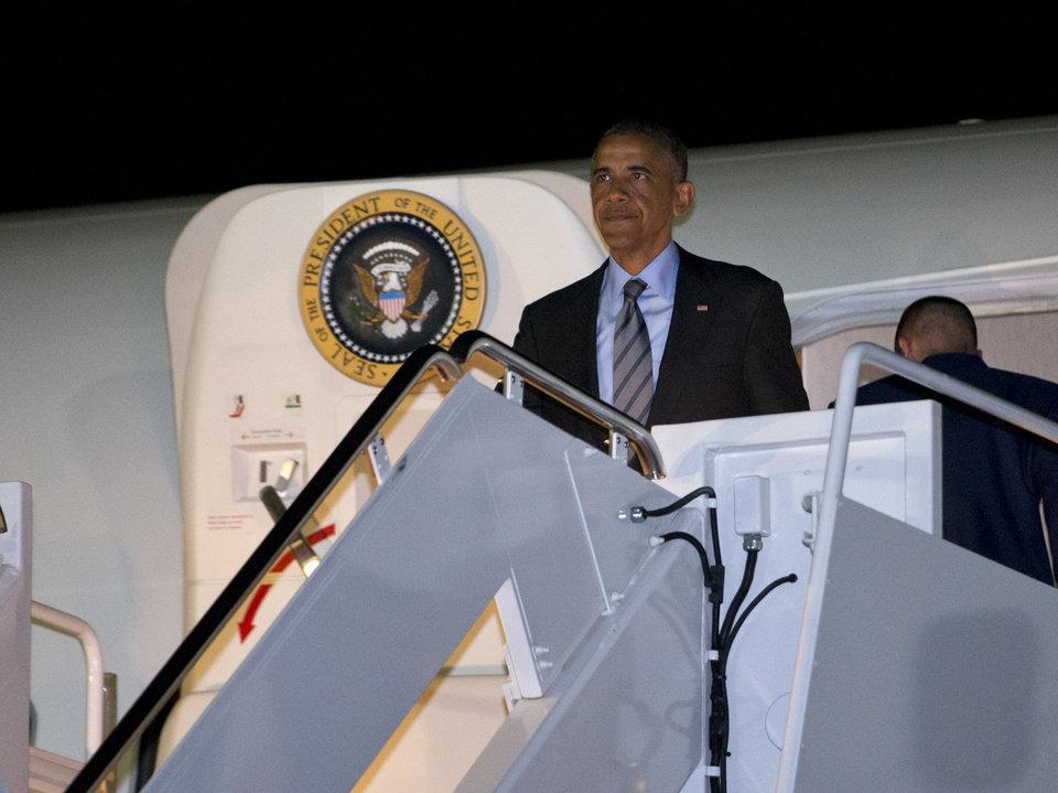 Photo - President Barack Obama exits Air Force One as he returns to Andrews Air Force Base, Md., Thursday, July 17, 2014, after stops in Delaware and New York. (AP Photo/Jacquelyn Martin)