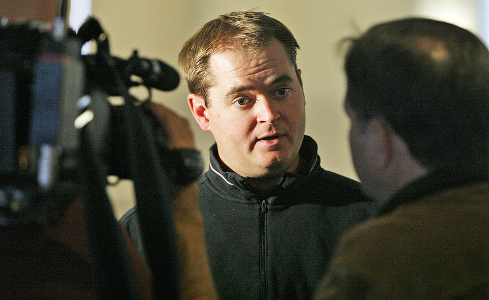 Photo - Former Sooner and current OU quarterback coach Josh Heupel and his father, Ken, will host a football camp in Oklahoma City in June. Photo by Chris Landsberger, The Oklahoman