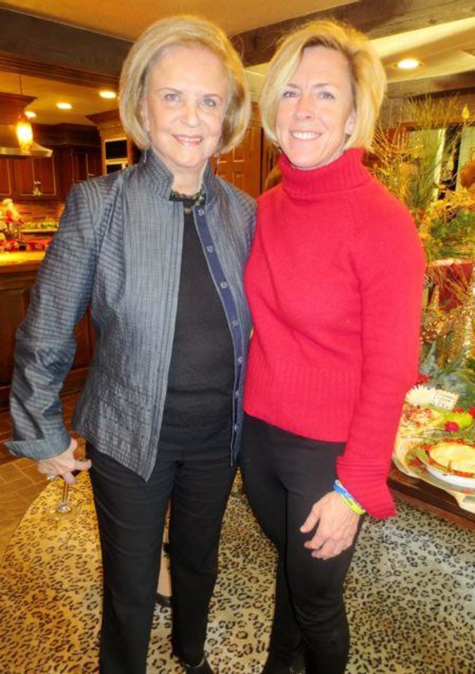 Pam Smith and Tricia Everest celebrate the season at the party in the home of Judy and Tom Love. (Photo by Helen Ford Wallace).