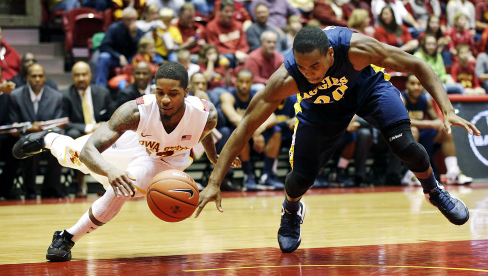 Photo -   Iowa State guard Korie Lucious, left, fights for a loose ball with North Carolina A&T guard Lamont Middleton during the first half of an NCAA college basketball game, Tuesday, Nov. 20, 2012, in Ames, Iowa. (AP Photo/Charlie Neibergall)