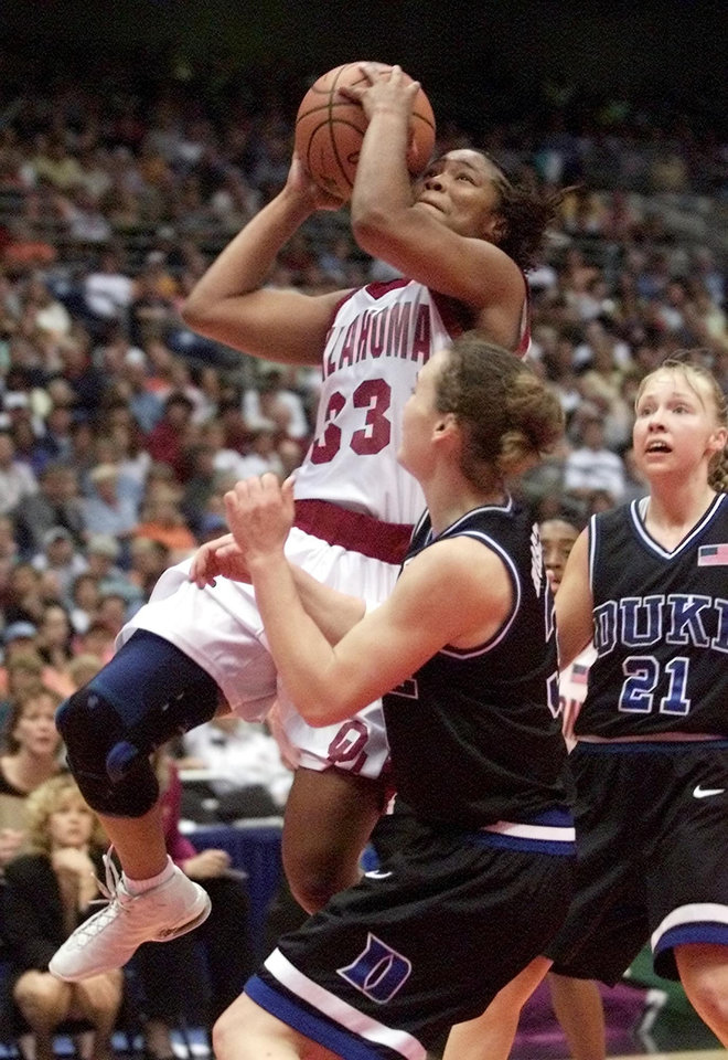Photo - NCAA TOURNAMENT, OU: University of Oklahoma vs Duke University in the Final Four 2002 NCAA Women's College Basketball Tournament played at the Alamodome in San Antonio, Texas,  Friday March 29, 2002.  OU's Rosalind Ross goes to the basket against Sheana Mosch. Trailing the play is Krista Gingrich. Staff photo by Doug Hoke.