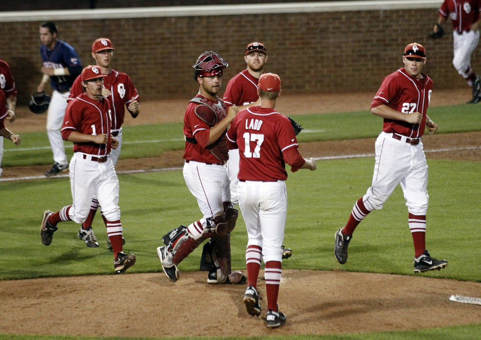 Photo - Oklahoma players celebrate their 5-4 victory over Virginia in their NCAA college baseball regional game in Charlottesville, Va., Sunday, June 3, 2012. (AP Photo/The Daily Progress, Andrew Shurtleff) ORG XMIT: VACHA302