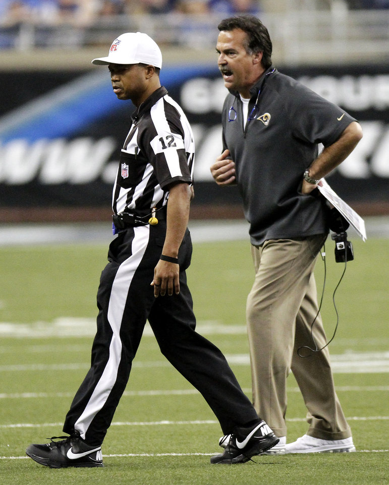 Photo -   St. Louis Rams coach Jeff Fisher, right, argues with NFL referee Donovan Briggans during the second quarter of an NFL football game against the Detroit Lions, Sunday, Sept. 9, 2012, in Detroit. The Lions defeated the Rams 27-23. (AP Photo/Duane Burleson)