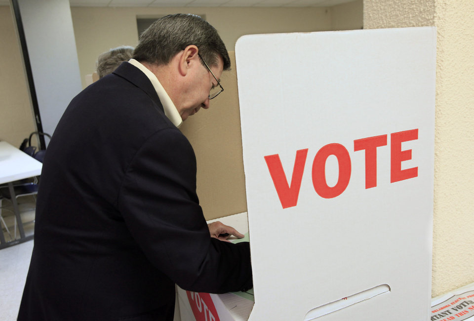 Photo - Attorney General Drew Edmondson, gubernatorial candidate, marks his ballot in the voting booths at precinct 574, Sooner and Hefner Road, in northeast Oklahoma City Tuesday, July 27, 2010. Photo by Paul B. Southerland, The Oklahoman