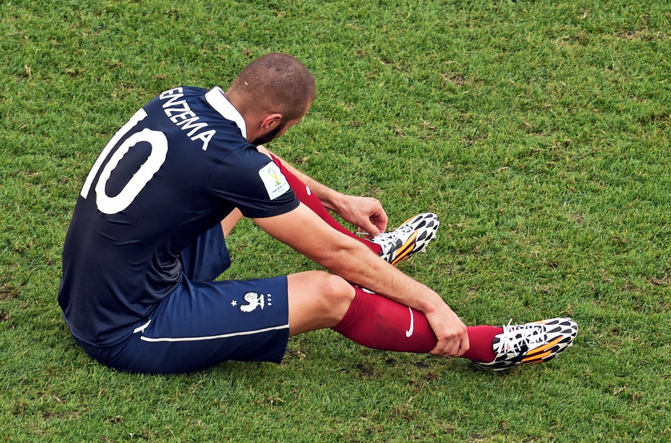 Photo - France's Karim Benzema sits on the pitch after the World Cup quarterfinal soccer match between Germany and France at the Maracana Stadium in Rio de Janeiro, Brazil, Friday, July 4, 2014. France lost 0-1. (AP Photo/Francois Xavier Marit, pool)