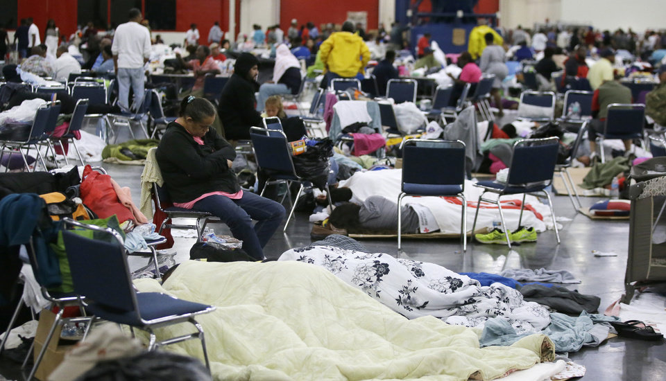 Photo - People rest at the George R. Brown Convention Center that has been set up as a shelter for evacuees escaping the floodwaters from Tropical Storm Harvey in Houston on Tuesday, Aug. 29, 2017. (AP Photo/LM Otero)