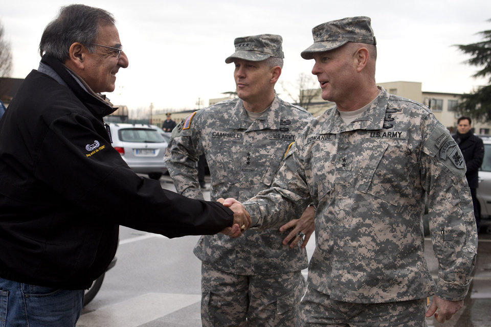 Photo - Defense Secretary Leon Panetta, left, is greeted by Commanding General U.S. Army Europe Lt. Gen. Don Campbell, center, and Commanding Gen. U.S. Army Africa Major Gen. Pat Donahue as the secretary arrives to speak to the 173rd Airborne Brigade Combat Team at U.S. Army Garrison in Vicenza, Italy, Thursday, Jan. 17, 2013. Panetta is in Italy as part of a weeklong swing across Europe, meeting with defense ministers to talk about ongoing conflicts in Afghanistan and Mali. This is expected to be Panetta's last overseas trip as Pentagon chief, as he long has planned to step down once his replacement is confirmed. (AP Photo/Jacquelyn Martin)