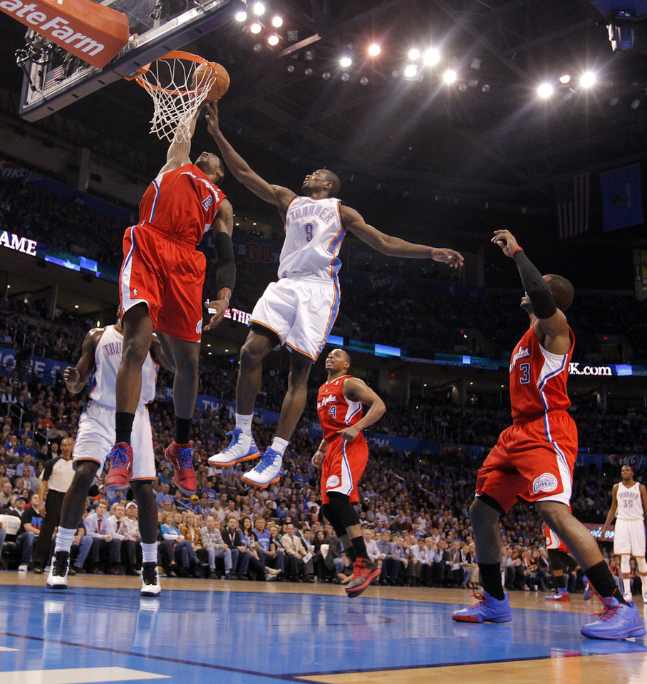 Los Angeles Clippers center DeAndre Jordan (6) and Oklahoma City Thunder power forward Serge Ibaka (9) battle for the ball during the NBA basketball game between the Oklahoma City Thunder and the Los Angeles Clippers at Chesapeake Energy Arena on Wednesday, March 21, 2012 in Oklahoma City, Okla.  Photo by Chris Landsberger, The Oklahoman