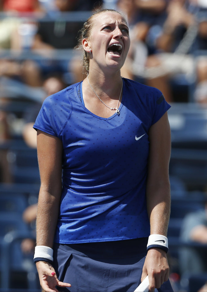 Photo - Petra Kvitova, of the Czech Republic, reacts after a point to Aleksandra Krunic, of Serbia, during the third round of the 2014 U.S. Open tennis tournament, Saturday, Aug. 30, 2014, in New York. (AP Photo/Kathy Willens)