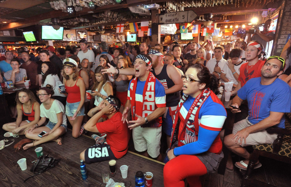 Photo - Fans show their frustration toward the end of the World Cup soccer match between the USA and Germany Thursday, June 26, 2014 at Lynch's Irish Pub in Jacksonville Beach, Fla. Germany won 1-0, but the USA advanced to the round of 16 anyway. (AP Photo/The Florida Times-Union, Will Dickey)