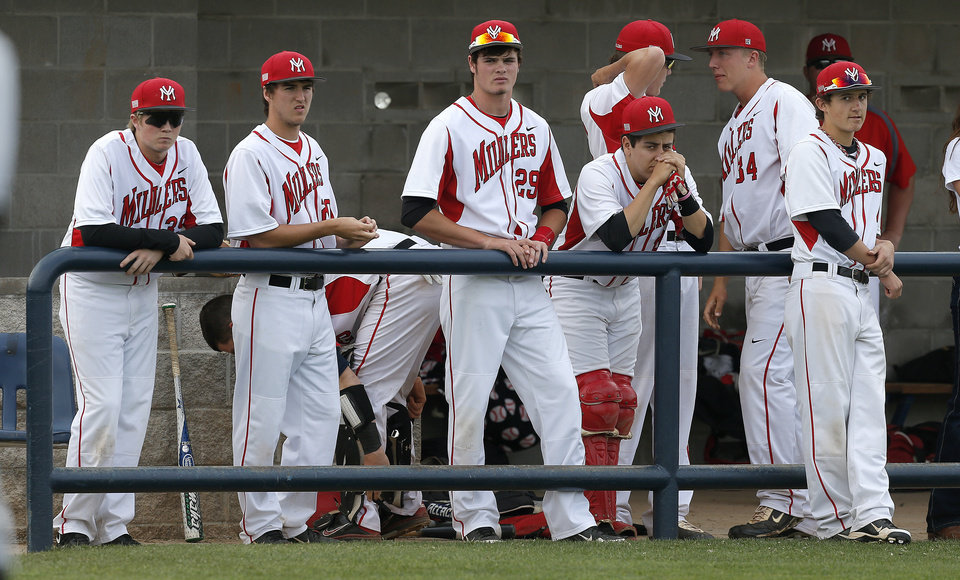 Photo - Yukon players watch Norman North celebrate after losing during a Class 6A state baseball tournament game in Shawnee, Okla., Friday, May 10, 2013. Photo by Bryan Terry, The Oklahoman