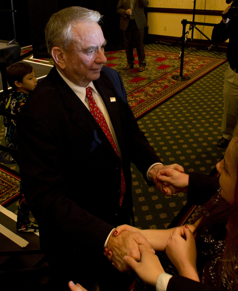Republican candidate for U.S. Senate, former Wisconsin Gov. Tommy Thompson, greets supporters with tears in his eyes after conceding the election Tuesday, Nov. 6, 2012 in Pewaukee, Wis. Thompson ran against Democratic challenger Tammy Baldwin who won the U.S. Senate seat vacated by Herb Kohl. (AP Photo/Jeffrey Phelps)
