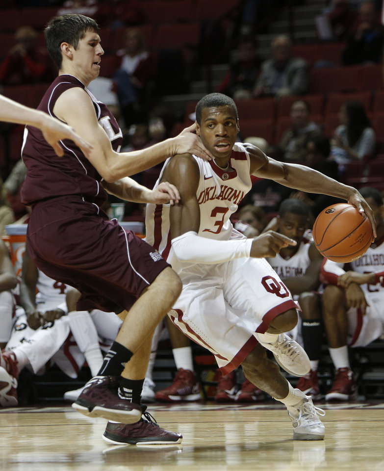 Photo - Oklahoma's Buddy Hield (3) drives the ball past Louisiana's Trent Mackey (5) during a men's college basketball game between the University of Oklahoma and the University of Louisiana-Monroe at the Loyd Noble Center in Norman, Okla., Sunday, Nov. 11, 2012.  Photo by Garett Fisbeck, The Oklahoman