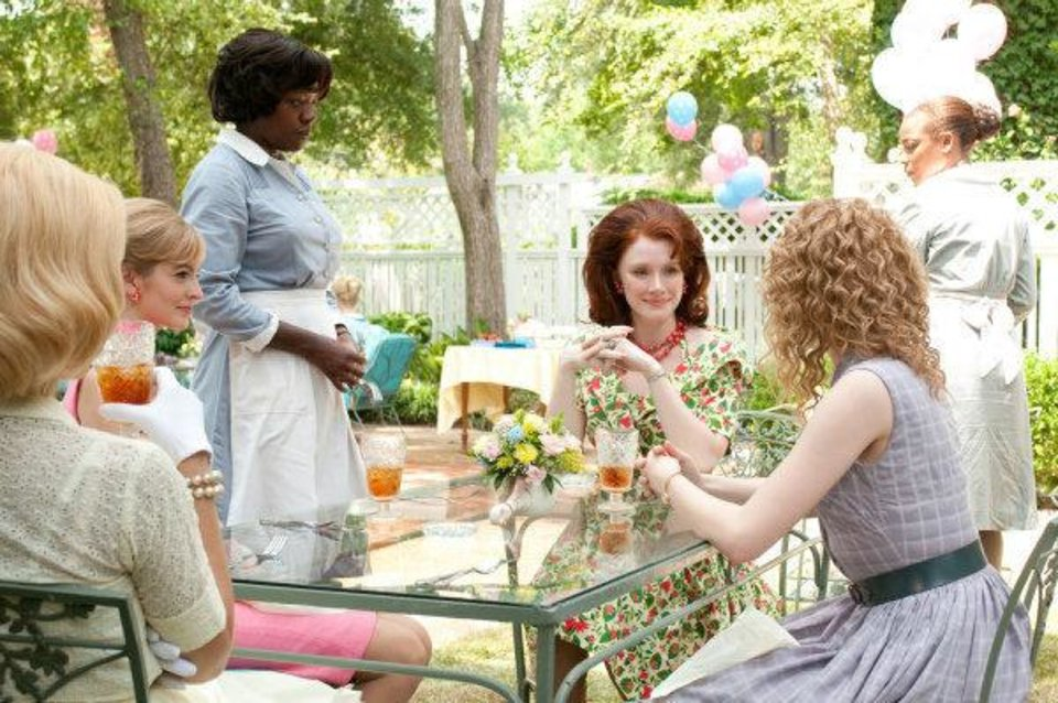 "Viola Davis, standing at left, stars in ""The Help"" with Bryce Dalls Howard, center, Ahna O'Reilly, left, and Emma Stone, right. Dreamworks photo <strong>Dale Robinette</strong>"