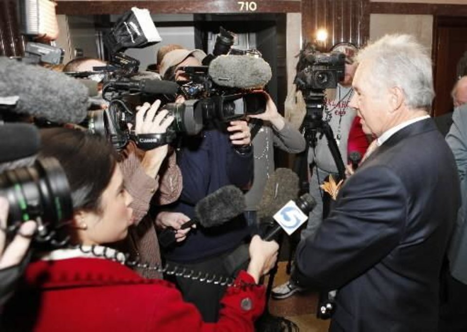 Photo - Defense attorney Irven Box talks with members of the media after a hearing in District Judge Ray C. Elliott's courtroom at the Oklahoma County Courthouse in Oklahoma City, December 7 , 2010. Photo by Steve Gooch, The Oklahoman