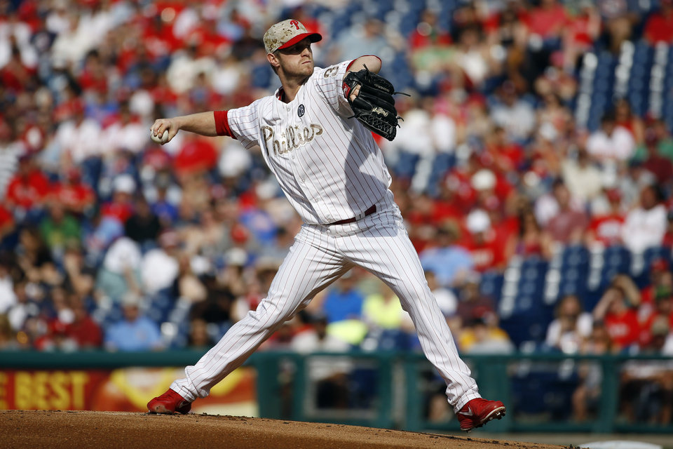 Photo - Philadelphia Phillies' Kyle Kendrick pitches during the first inning of a baseball game against the Colorado Rockies, Monday, May 26, 2014, in Philadelphia. (AP Photo/Matt Slocum)