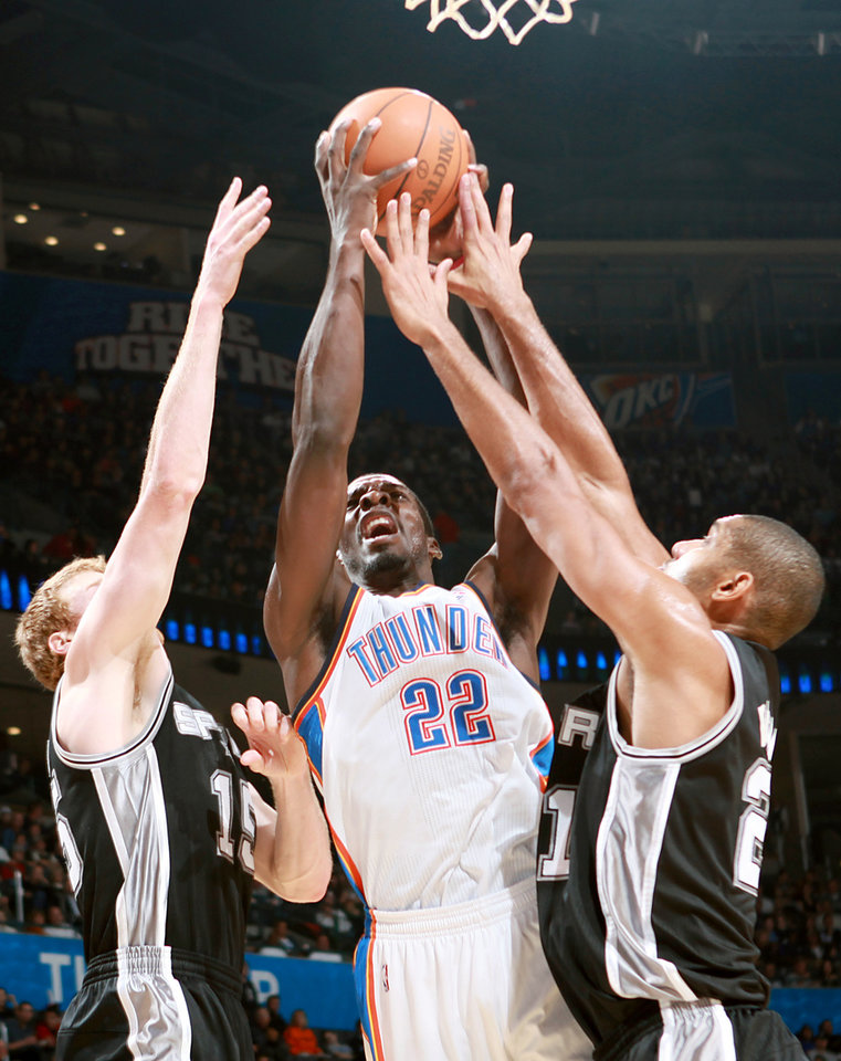 Photo - Oklahoma City's Jeff Green puts up a shot between  San Antonio's Matt Bonner (left) and Tim Duncan during their NBA basketball game in downtown Oklahoma City  on Sunday, Nov. 14, 2010.Photo by John Clanton, The Oklahoman