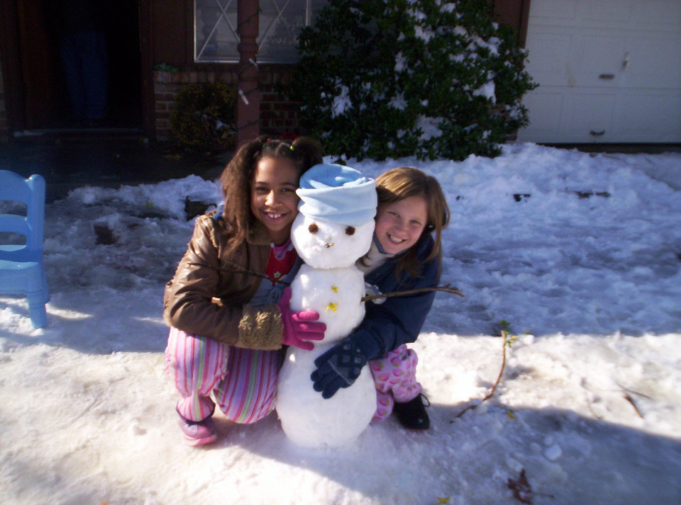 Lexi and Jodey with their snowman<br/><b>Community Photo By:</b> Leah<br/><b>Submitted By:</b> Leah, Midwest City