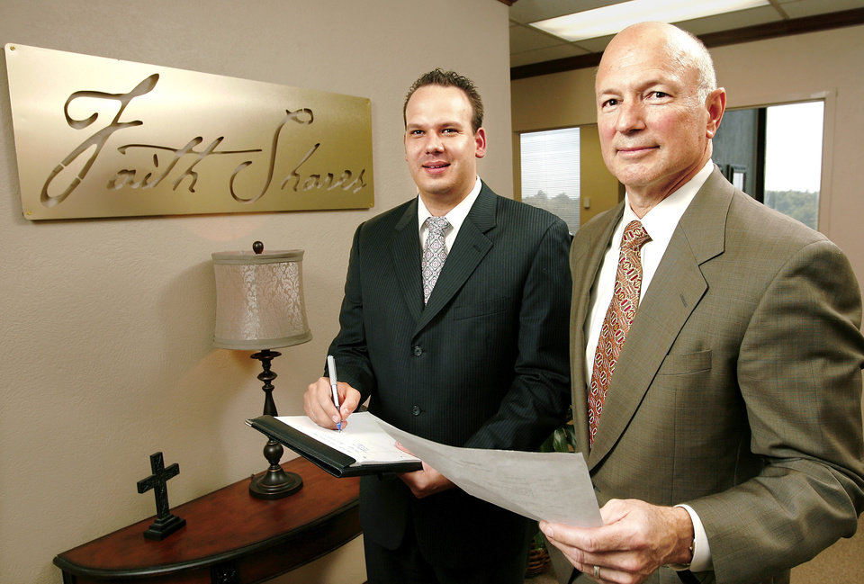 Photo - Garrett Stevens, left, and Tom Phillips stand Wednesday in the northwest Oklahoma City offices of their company, FaithShare Trust. Stevens is chief executive. Phillips serves as president. PHOTO BY JIM BECKEL, THE OKLAHOMAN