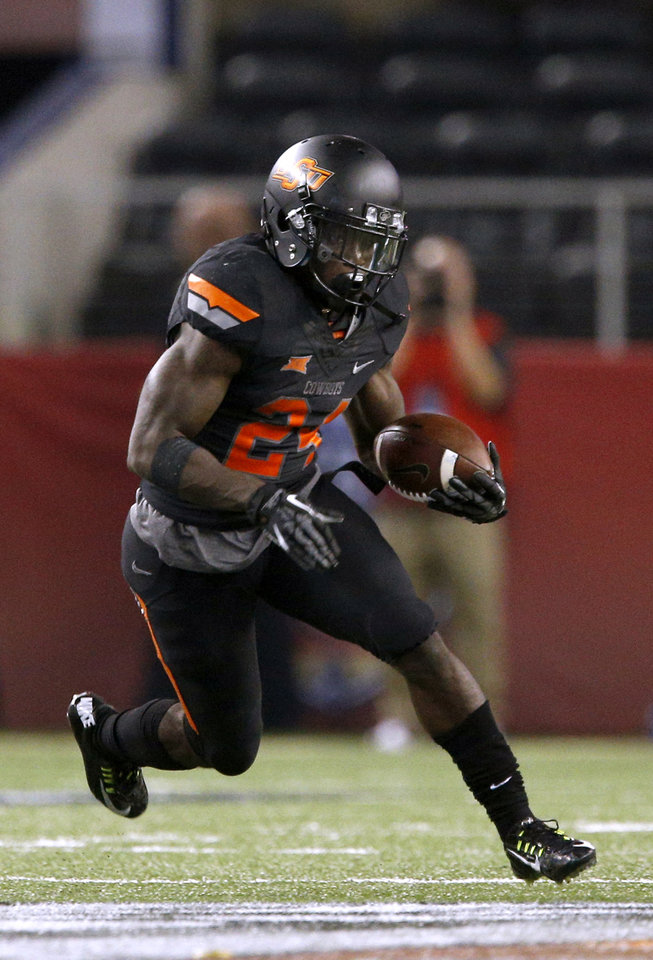 Photo - Oklahoma State's Tyreek Hill (24) rushes up field during the college football game between Oklahoma State University (OSU) and Florida State University (FSU) at the AdvoCare Cowboys Classic at At&T Stadium in Arlington, Texas,  Saturday, Aug. 30, 2014. Photo by Sarah Phipps, The Oklahoman