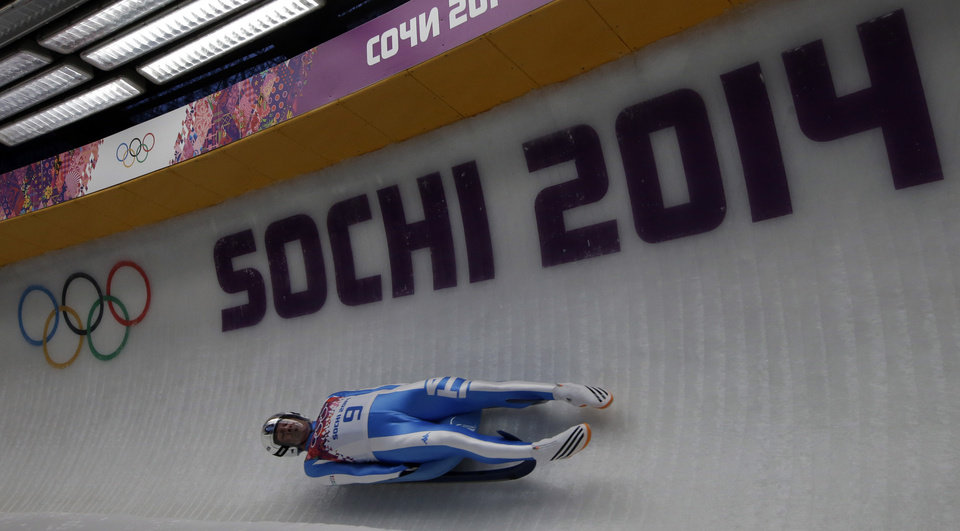 Photo - Armin Zoeggeler of Italy takes turn five during the men's singles luge final at the 2014 Winter Olympics, Sunday, Feb. 9, 2014, in Krasnaya Polyana, Russia. (AP Photo/Dita Alangkara)