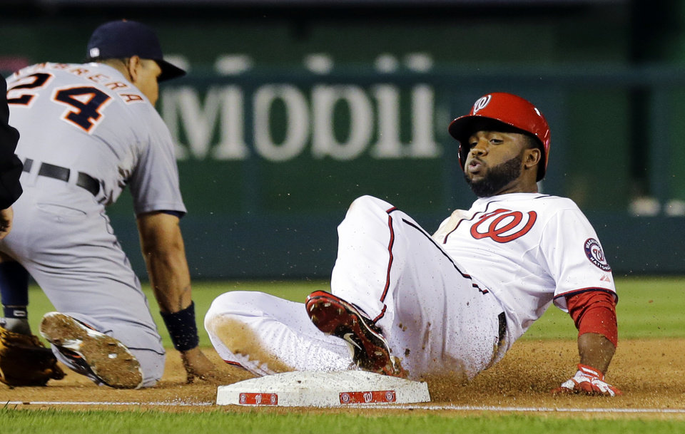 Photo - Washington Nationals' Denard Span, right, slides safely into third for a triple as Detroit Tigers third baseman Miguel Cabrera (24) waits for the ball during the third inning of a baseball game at Nationals Park, Wednesday, May 8, 2013, in Washington. (AP Photo/Alex Brandon)