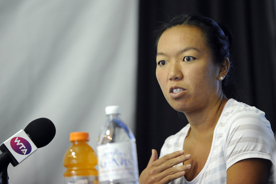 Photo - Vania King speaks to the media at the Citi Open tennis tournament, Friday, Aug. 1, 2014, in Washington. King withdrew from the tournament due to an injury. (AP Photo/Nick Wass)