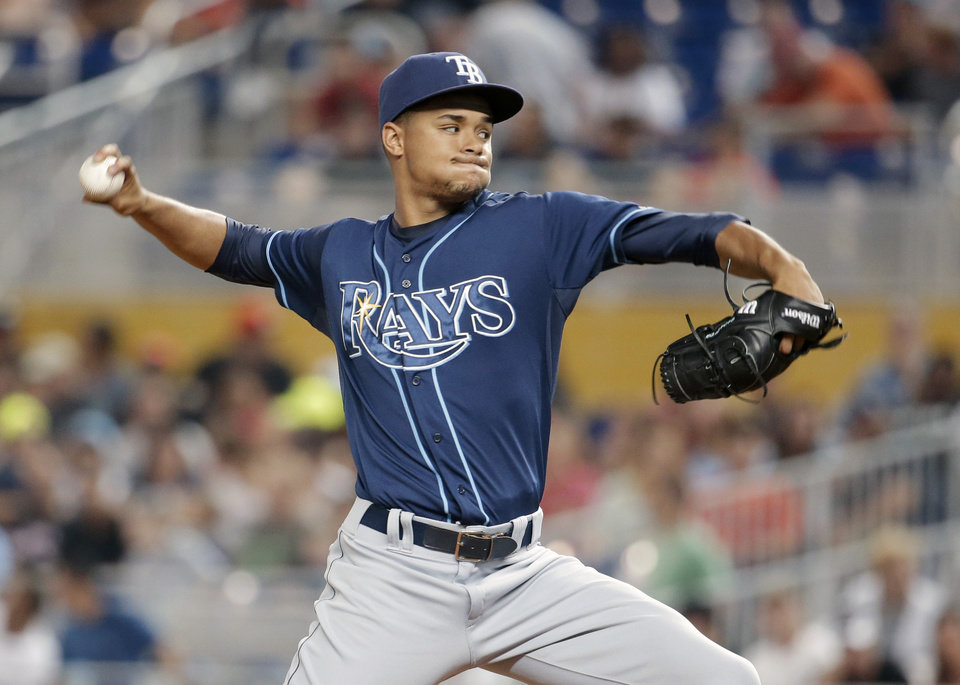 Photo - Tampa Bay Rays starting pitcher Chris Archer throws during the first inning of an interleague baseball game against the Miami Marlins, Tuesday, June 3, 2014, in Miami. (AP Photo/Lynne Sladky)