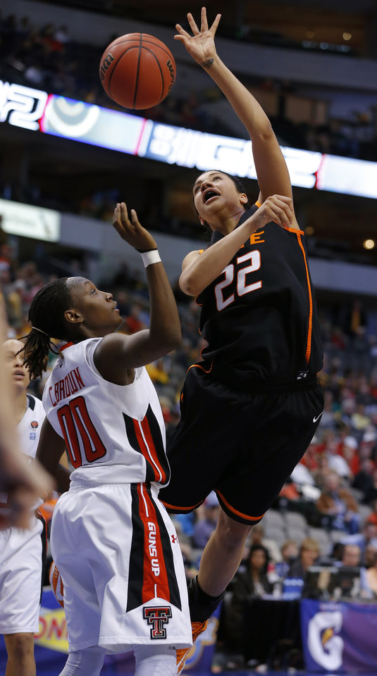 Oklahoma State's Brittney Martin (22) shoots the ball over Texas Tech's Chynna Brown (00) during the Big 12 tournament women's college basketball game between Oklahoma State University and Texas Tech University at American Airlines Arena in Dallas, Saturday, March 9, 2012. Oklahoma State won 59-54.  Photo by Bryan Terry, The Oklahoman