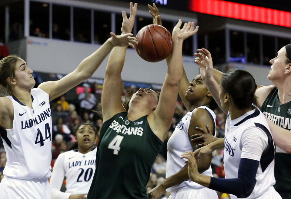 Michigan State center Jasmine Hines (4) battles for a rebound against Penn State forward Tori Waldner (44), forward Mia Nickson, third from right, and guard Dara Taylor (2), second from right, during the first half of an NCAA college basketball game in the Big Ten Conference tournament in Hoffman Estates, Ill., Saturday, March 9, 2013. (AP Photo/Nam Y. Huh)