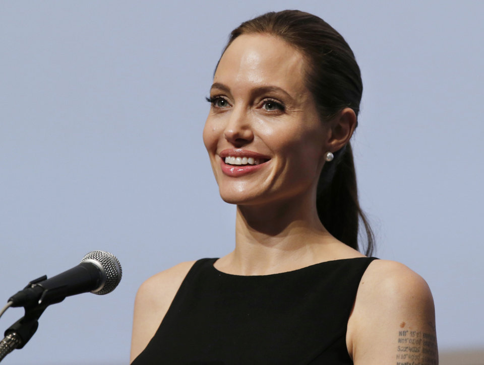 Photo - Angelina Jolie delivers a statement before screening the film